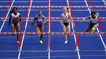 Great Britain's Tiffany Porter (right) winning the women's 100m hurdle final during day three of the