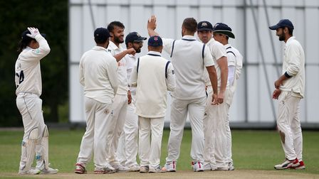 E Kalley of Wanstead celebrates with his team mates after taking the wicket of A West during Wanstea