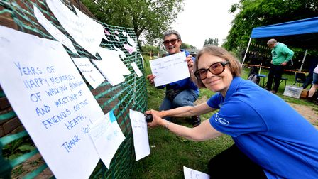 Heath hands volunteers Mary Goyder and Jean Early create a display of artwork and people'smemories of the Heath