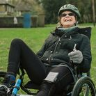 Picture shows a woman using an adapted bike