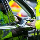 A PSNI Road Policing officer prepares a breathalyser test during a random drink driving checkpoint i