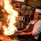 Hot stuff... in the kitchens preparing eastern cuisine for diners in east London.