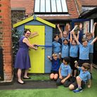 New End headteacher Karyn Ray opening the book hut with year 4 pupils