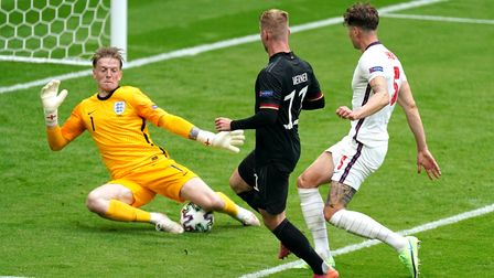 England goalkeeper Jordan Pickford (left) makes a save from Germany's Timo Werner during the UEFA Eu
