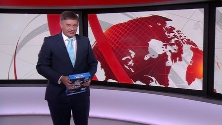 Simon McCoy presents the BBC News with a ream of printer paper