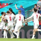England's Raheem Sterling (left) celebrates scoring their side's first goal of the game during the U