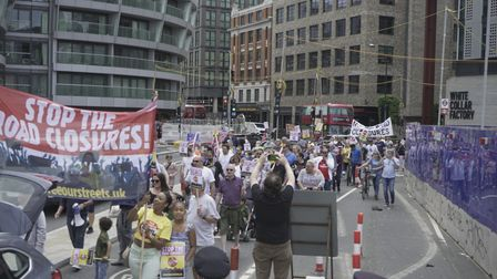 Protesters marching through Old Street roundabout.