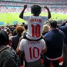 England's Raheem Sterling son Thiago celebrates with family after the final whistle during the UEFA