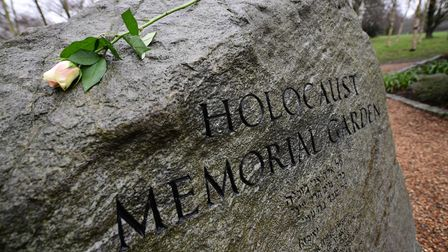 A rose is placed on the stone in the Holocaust Memorial Garden in Hyde Park, London, to help mark Ho
