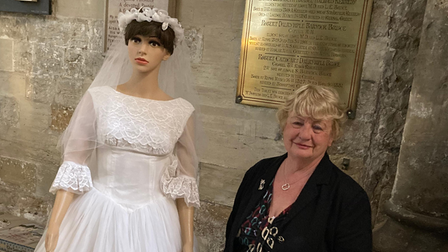 Christine Wood and the wedding dress she was reunited with after a lockdown clear out