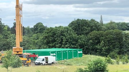 Green temporary buildings on the football pitch