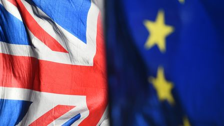 Union and European Union flags are flown outside the Houses of Parliament, London.