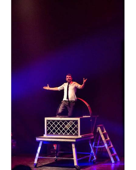 Jez Bond performing one of his illusions