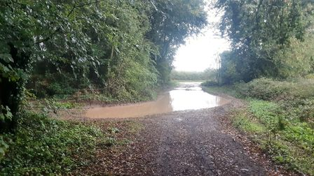 Deep ruts under sitting water waited to tear the little cars underneath off