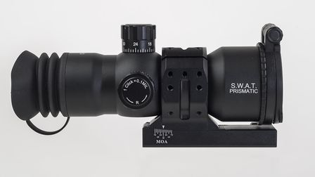 This ultra-short eye relief scope - MTC Optic's SWAT Prismatic - comes with an adjustable mount