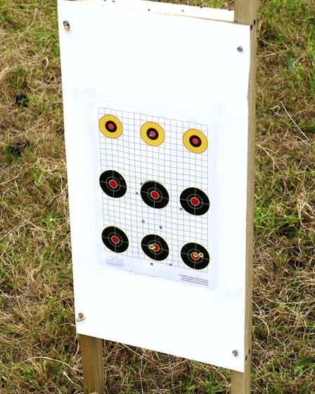 A homemade tall target stand with an easily replaceable fibreboard panel