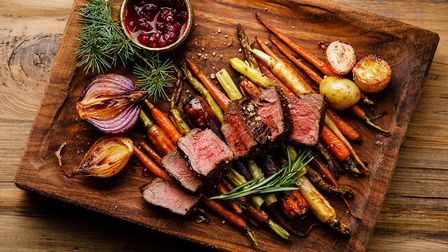 Grilled sliced Venison Steak with baked vegetables and berry sauce, what's not to like!