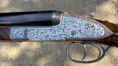 William & Son side-locks are mechanically Holland & Holland assisted openers, this one engraved by P