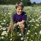 Casper Lee-Motzkau with his discovery of a lizard orchid.