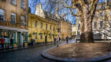 RJ31GD Shops and pub in Abbey Green, Bath, Somerset, UK on 4 February 2019