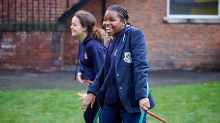 Happy and cheerful students enjoying an outdoor lesson at Wakefield Girls' High School in Yorkshire, England.