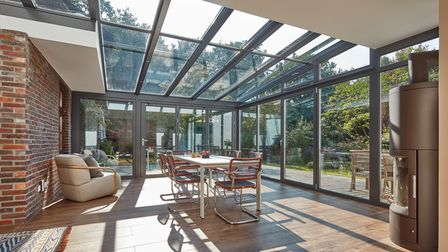 Solarlux Wintergarden glass extension with glass roof installed by Reveal Doors and Windows in Yorkshire