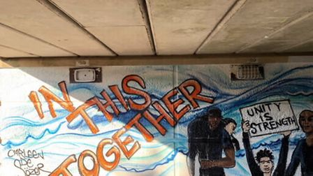 A segment of the Martins Way underpass, which reads 'in this together'
