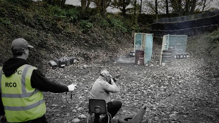 Shooting from a seated position. Not something youll encounter on the average clay ground