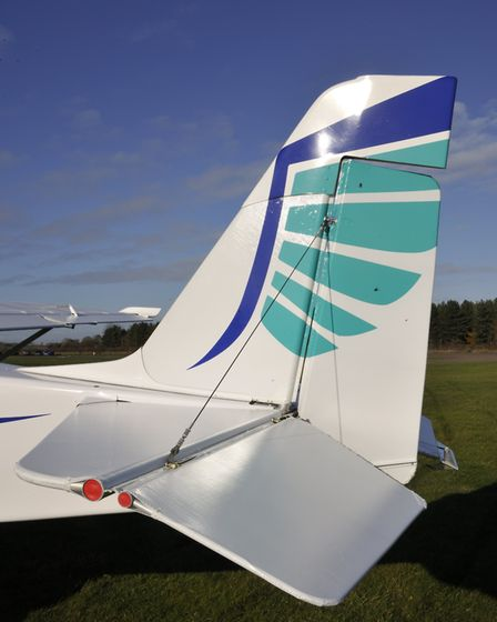 Tail feathers - note the exposed and plugged tailplane and elevator tubes, and fin extension cuff, p