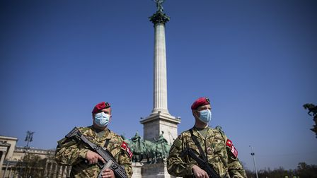 BUDAPEST, HUNGARY - APRIL 06: Military officers patrol the deserted Heroes' Square as the spread of