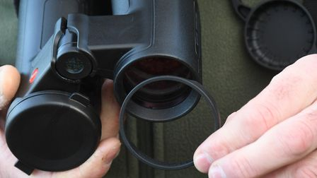 Objective lens covers benefit from being taped in position