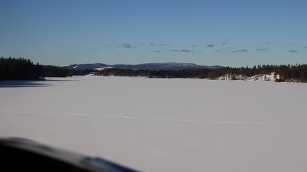 Low pass over Hundsjöns lake to ascertain whether landing is safe. If conditions are right, any suff