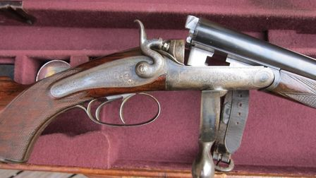 A typical hammer black-powder express rifle with a Jones lever and a doll's head extension
