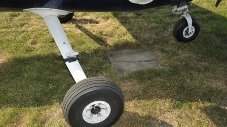 Streamline fairings disguise the mainwheel spring, which is a simple tube that bends under load