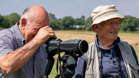 A Curlew fieldworker and a farmer looking for Curlews (Credit: WWT)