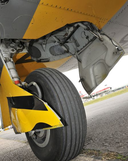 The stumpy main undercarriage legs retract outwards and are fully covered when up