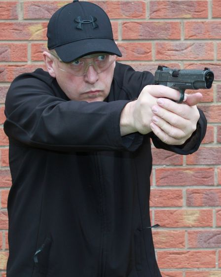 Tim shooting the 1911 WE THE PEOPLE