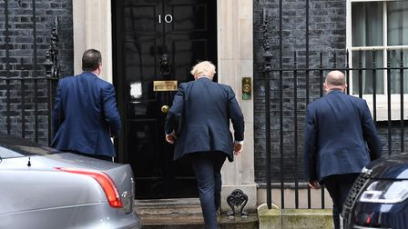 Prime Minister Boris Johnson arriving in Downing Street. Photograph: Stefan Rousseau/PA.