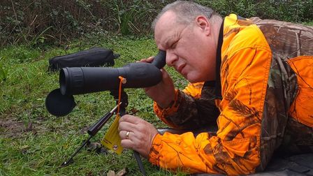 A cheap 20 spotting scope or you could use an old telescopic sight