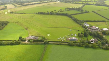 Devon airfield and home for sale - 2 runways and a hangar for several aircraft, offers in excess of