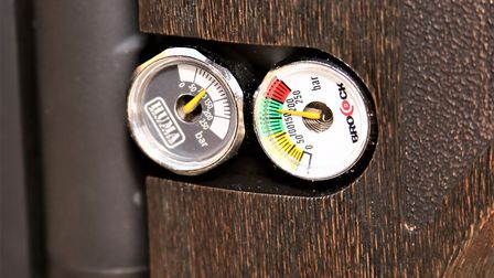 Power and control. The twin gauges monitor reservoir and regulator pressures.