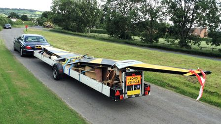 Quite an overhang, even when using such a long trailer Bob's DIY transport saved expense but had it
