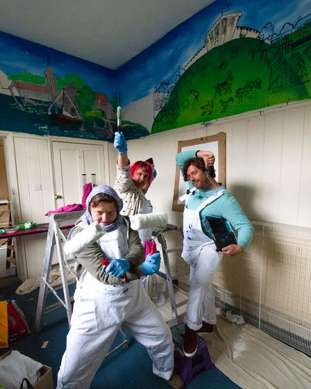 Norwich Dandies painting mural at new community library