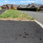 Rough chippings left after pavement resurfacing at Ivydale, Exmouth. Ref exe 9760-26-15AW. Picture:
