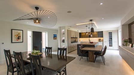 A modern kitchen and dining area designed and installed by Steven Christopher Designs