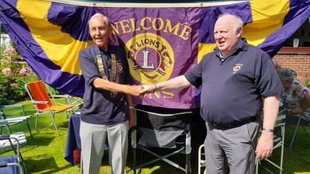 Incoming president of Paignton Lions Club, Lion Malcolm Stone (left) with outgoing president Lion Alan Tozer