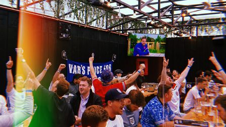 Hackney football fans celebrate in BOXPARK Shoreditch during EURO 2020.