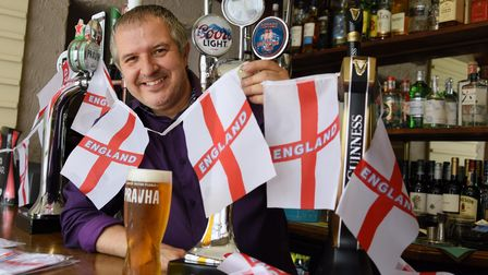 Phil Cutter decorates the Murderers as he prepares for the England against Ukraine football match in