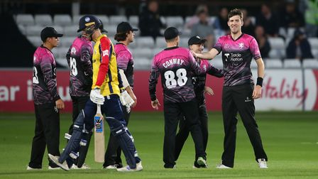 Craig Overton of Somerset celebrates with team mates after taking a wicket in the Vitality Blast T20