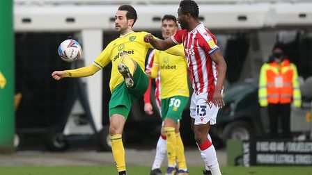 Mario Vrancic of Norwich and Mikel John Obi of Stoke City in action during the Sky Bet Championship